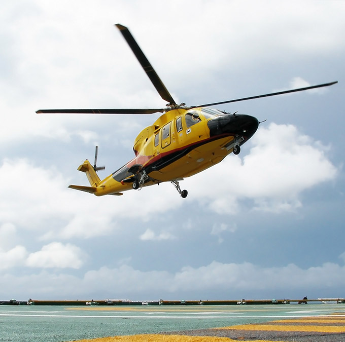 yellow helicopter landing